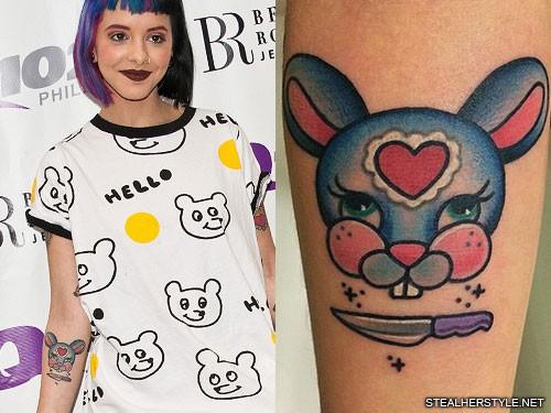 melanie martinez heart knife rabbit forearm tattoo