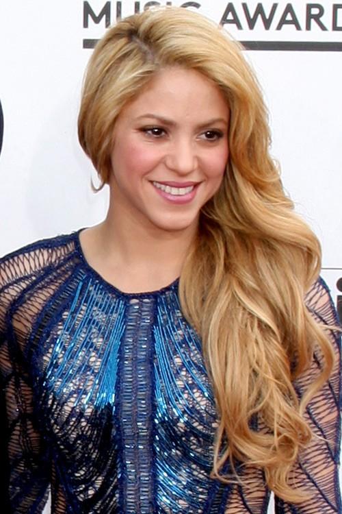 Shakira Wavy Honey Blonde Faux Sidecut Side Part