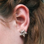 sydney-sierota-ear-piercing