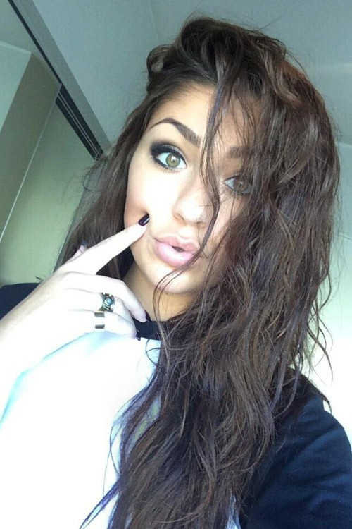 Andrea Russett Wavy Dark Brown Messy Hairstyle | Steal Her Style