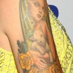 cherish-lee-portrait-arm-tattoo