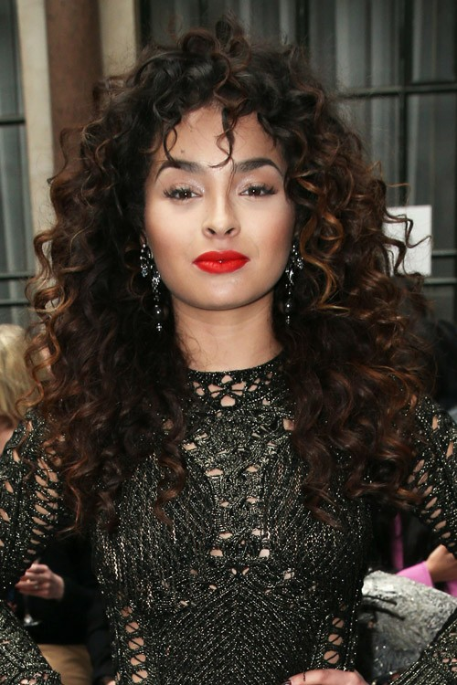 Ella Eyre Curly Dark Brown Afro Thin Bangs Hairstyle