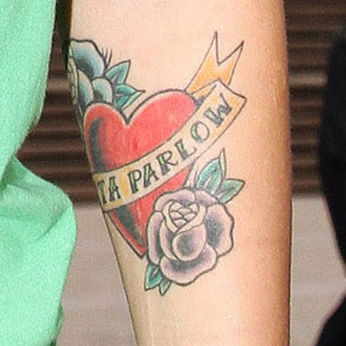Ruby rose 39 s 19 tattoos meanings steal her style page 2 for Rose tattoos on arm