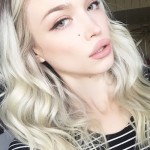Platinum blonde angled dark roots messy hairstyle steal her style