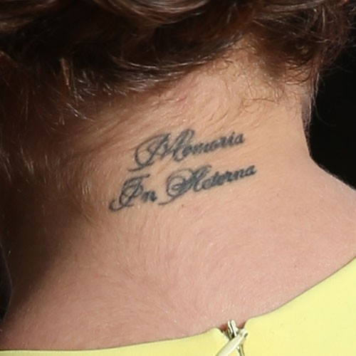 Celebrity neck tattoos steal her style for Cursive neck tattoos