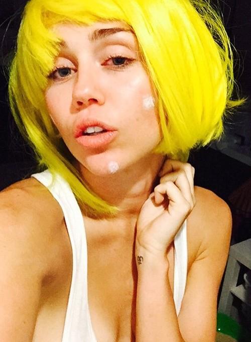 miley cyrus straight yellow bob choppy bangs uneven