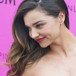 Miranda Kerr arrives at Magnum beach during the 68th annual Cannes Film Festival
