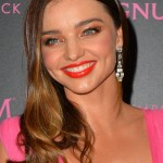 Miranda Kerr poses for photographs in pink at Magnum beach during the 68th annual Cannes Film Festival