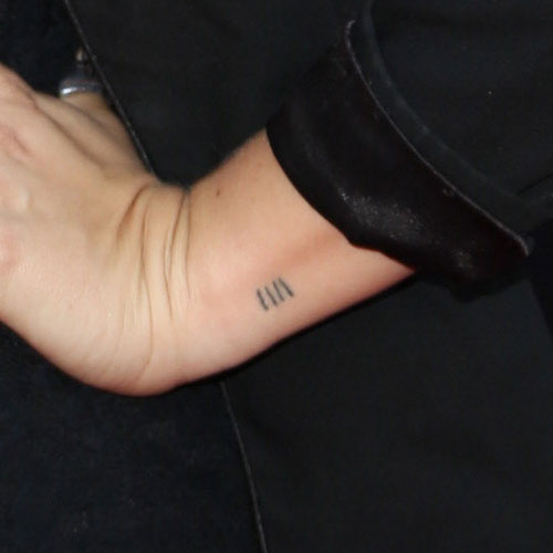 scout-taylor-compton-lines-wrist-tattoo