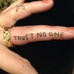 bethany-cosentino-trust-no-one-finger-tattoo