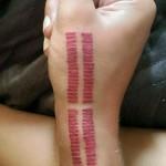niykee-heaton-tattoo-hand-red-lines