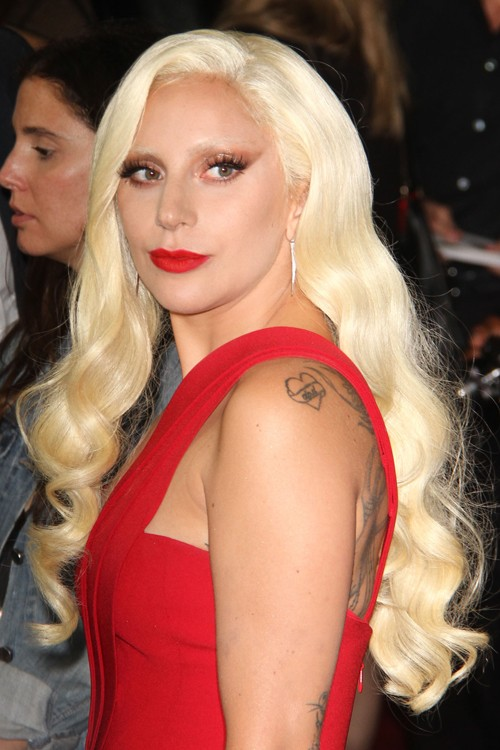 lady gaga wavy golden blonde barrel curls hairstyle