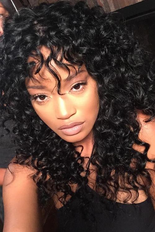 Keke Palmer Curly Black Afro Choppy Bangs Hairstyle