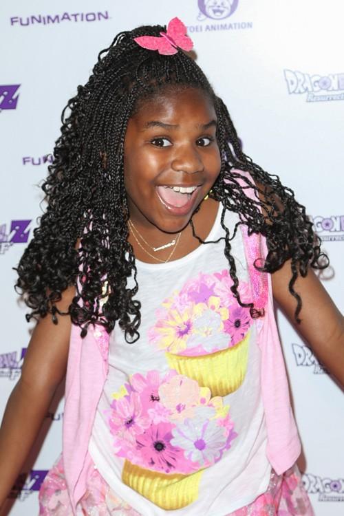 Trinitee Stokes Curly Dark Brown Afro Mini Braids Pompadour Hairstyle