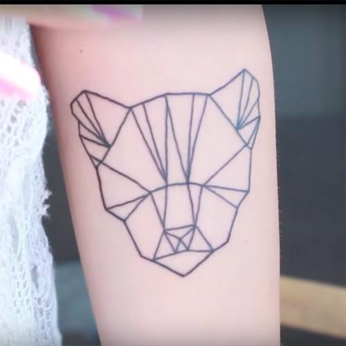 Sara Forsberg Lion Origami Forearm Tattoo