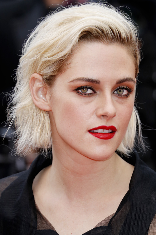 Kristen Stewart Wavy Platinum Blonde Dark Roots Hairstyle