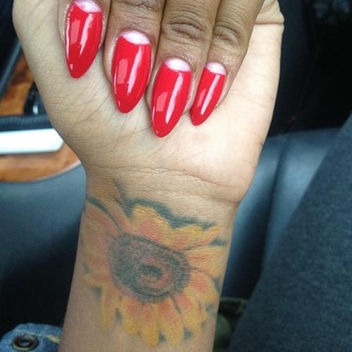 5b1fbe2643502 Eva Marcille Flower, Sunflower Wrist Tattoo | Steal Her Style