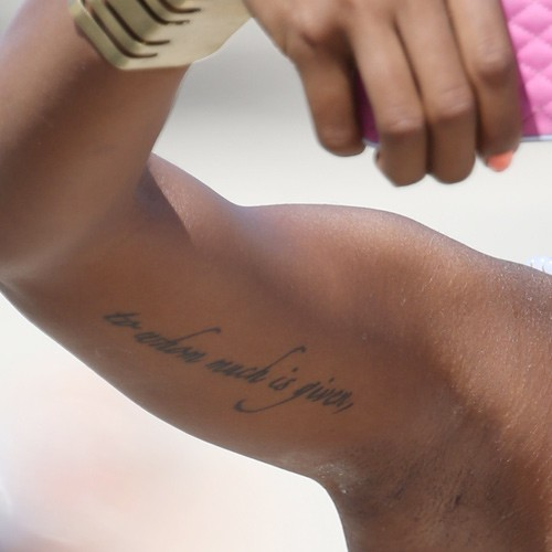 Eva marcille writing bicep tattoo steal her style for How much is a tiny tattoo
