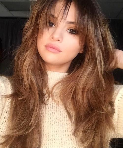 Selena Gomez Wavy Medium Brown Choppy Bangs Long Layers Hairstyle