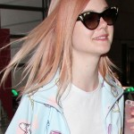 154835, A sporty Elle Fanning shows off her rose gold hair as she catches her departing flight out of LAX. Los Angeles, California - Tuesday July 12, 2016. Photograph: © PacificCoastNews. Los Angeles Office (PCN): +1 310.822.0419 UK Office (Photoshot): +44 (0) 20 7421 6000 sales@pacificcoastnews.com FEE MUST BE AGREED PRIOR TO USAGE