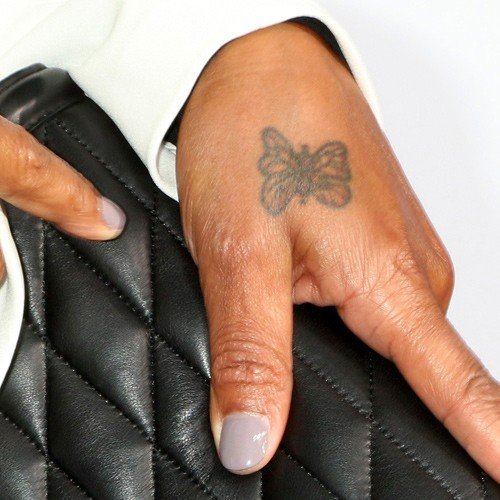 Queen Latifah S Tattoos Meanings Steal Her Style