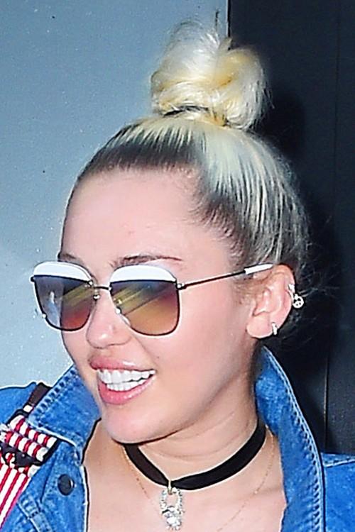 Miley Cyrus Straight Platinum Blonde Bun Dark Roots