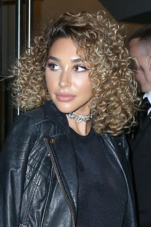 chantel jeffries curly light brown dark roots hairstyle