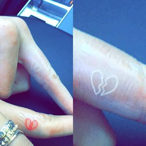 a0e2e9342 Instagram / @jonboytattoo. Leave a Comment. Kendall Jenner has a matching  broken heart tattoo ...