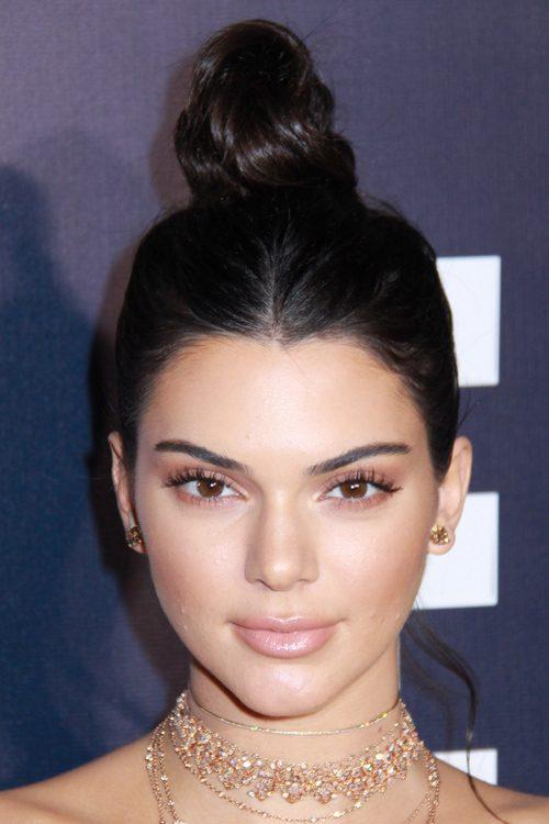 kim kardashian straight hairstyles : Kendall Jenner Straight Dark Brown Bun Hairstyle Steal Her Style