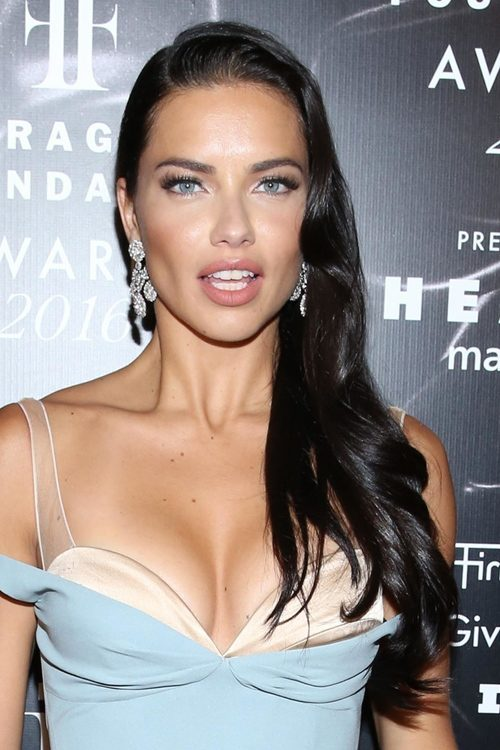 Adriana Lima Wavy Black Long Layers Side Part Hairstyle