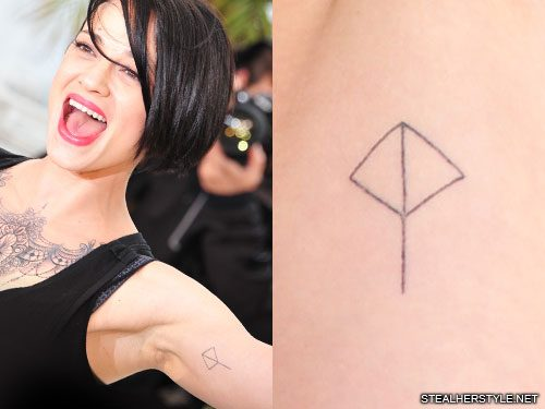 Asia Argento Logo Bicep Tattoo | Steal Her Style