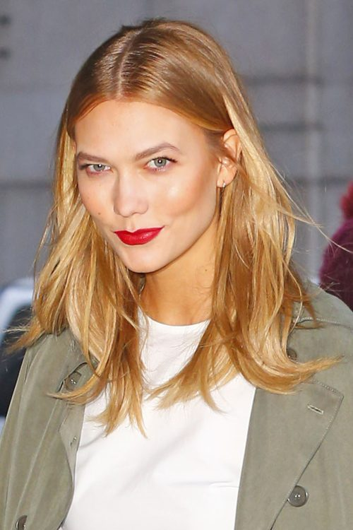Karlie Kloss Straight Honey Blonde Angled Dark Roots Hairstyle Steal Her Style