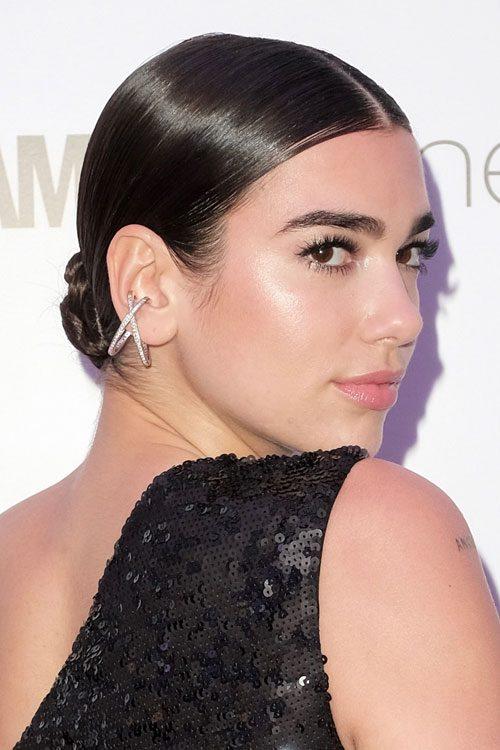 Dua Lipa Straight Dark Brown Bun Hairstyle Steal Her Style
