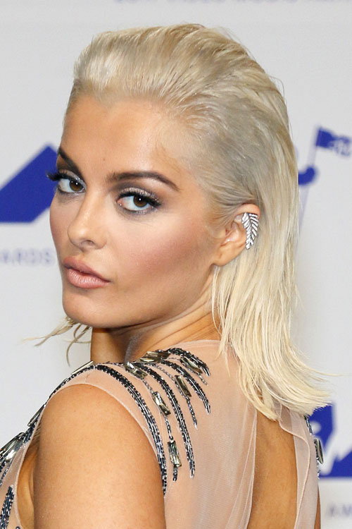 Bebe Rexha Straight Platinum Blonde Slicked Back Hairstyle