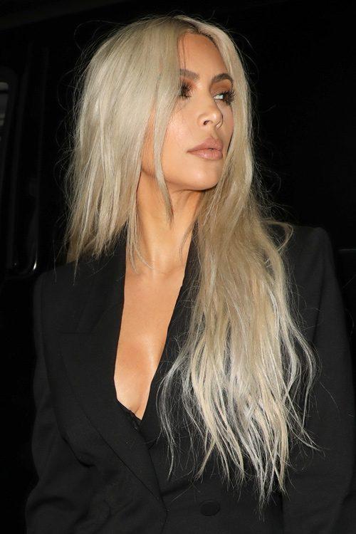 Kim Kardashian Wavy Platinum Blonde Angled Side Part Hairstyle