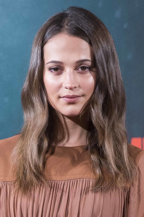 Alicia Vikander S Hairstyles Amp Hair Colors Steal Her Style