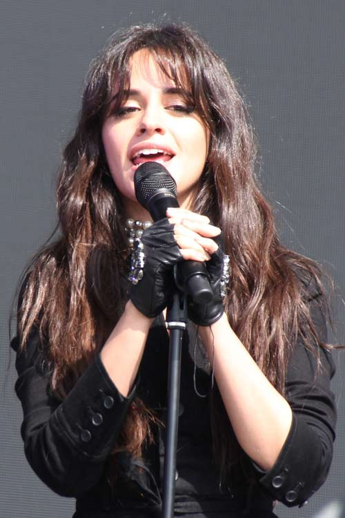 Camila Cabello Wavy Dark Brown Overgrown Bangs Hairstyle