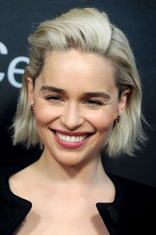Emilia Clarke Wavy Platinum Blonde Dark Roots Hairstyle
