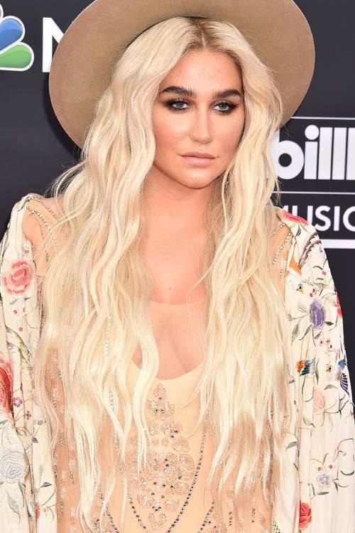 Kesha Wavy Platinum Blonde Angled Dark Roots Hairstyle