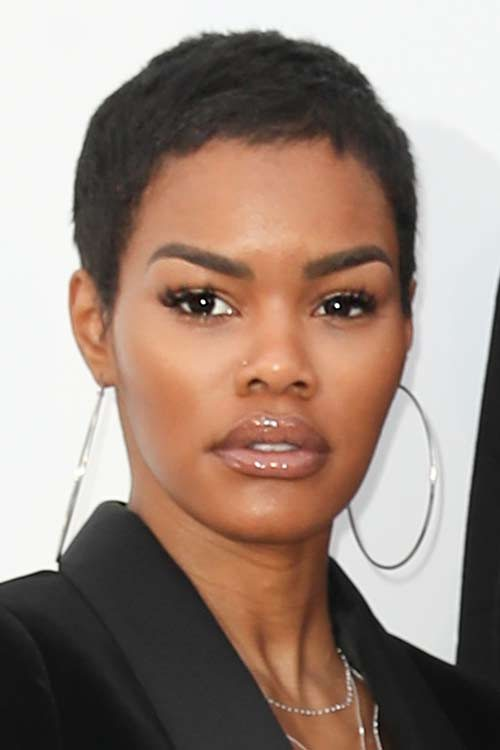 Teyana taylor 39 s hairstyles hair colors steal her style for Teyana taylor tattoos